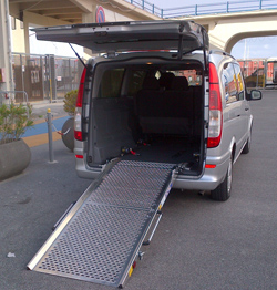 Minivan with ramp for wheelchair confined people