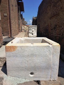 <b>One of the many fountains along Pompeii ruins streets</b>